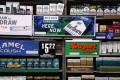 Camel and Newport cigarettes, both Reynolds American brands, are on display at a Smoker Friendly shop in Pittsburgh. British American Tobacco Plc has agreed to fully take over Reynolds American Inc. on terms that are improved from an initial bid made last year. Photo: AP
