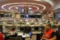 Traders work on the trading floor at the Hong Kong Stock Exchange in Central. Photo: Dickson Lee