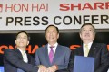 Terry Gou (C), founder and Chairman of Taiwan's Foxconn, formally known as Hon Hai Precision Industry, shakes hand with the company's Vice Chairman Tai Jeng-wu (L) and Japan's Sharp Corp Chief Executive Kozo Takahashi at their joint news conference in Sakai, western Japan, in 2016. Photo: Reuters.