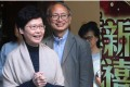 Carrie Lam with media relations officer Tai Keen-man at her campaign office yesterday. Lam trails John Tsang in opinion polls but is seen as Beijing's favourite. Photo: David Wong