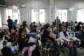 Chinese families accompany their children to get flu to rabies shots at a hospital in Hefei. Photo: AFP