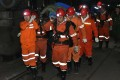 Rescuers carry a survivor from Danshuigou coal mine, near Shuozhou, last Wednesday following the tunnel collapse. Photo: Xinhua