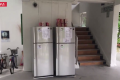 The fridges on Tampines Street are part of a community initiative where needy residents can take food — including eggs, meat and fruits — donated by others. Photo: Kenneth Cheng/TODAY