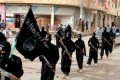 A file photo of Islamic State fighters marching in Raqqa, Syria. Photo: AP