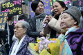 Nguyet Thi Thanh, one of the survivors of a Vietnam War massacre committed by South Korean soldiers, speaks at a weekly demonstration by former comfort women in front of the Japanese Embassy in Seoul, during her first visit to Korea last April. Shim Hyun-chul/Korea Times