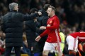Jose Mourinho congratulates Wayne Rooney after the striker is substituted. Photo: Reuters