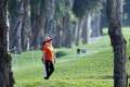 A staff member walks around the Fanling course during the Hong Kong Open golf tournament in 2015. Photo: Edward Wong