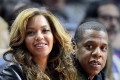 US singers Beyonce (L) and her husband Jay Z (R) sit courtside at the Brooklyn Nets at Los Angeles Clippers NBA basketball game in Los Angeles, California. Beyonce Knowles is pregnant with twins as she and her husband Jay Z confirmed via social media. Photo: EPA