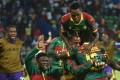 Cameroon players celebrate their second goal during the 2017 Africa Cup of Nations semi-final match against Ghana. Photo: AFP