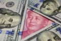 With the US dollar index close to historic highs, China has a great opportunity to radically reform its exchange rate mechanism and pave the way for greater internationalisation of the renminbi. Photo: Reuters
