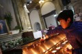 A file picture of a boy lighting candles at a state-approved Catholic church in Beijing. Photo: EPA