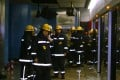 Firemen inspect a damaged MTR compartment in Admiralty station after the 2004 attack. Photo: Robert Ng