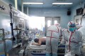Medical workers in protective suits treat a patient with the H7N9 strain of bird flu at a hospital in Wuhan in Hubei province earlier this month. Photo: AFP