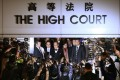 Donald Tsang Yam-kuen and wife Selina Tsang Pou Siu-mei (centre) left the High Court in Admiralty on Friday night after the verdicts. Photo: Felix Wong