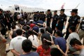 Taiwanese and mainland Chinese suspects of telecom fraud await deportation from Cambodia to mainland China at Phnom Penh in June 2016. Photo: Reuters