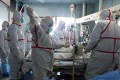 An H7N9 bird flu patient is treated in a hospital in Wuhan, Hubei province. A mutation of the strain has been found in Guangdong province. Photo: AFP