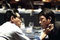 Hwang Jung-min (left) and Jung Woo-sung in a still from Asura (category III, Korean), directed by King Sung-soo.