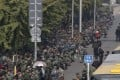 A file picture of hundreds of protesters in green fatigues outside the Chinese Ministry of National Defence last October. They were protesting over pensions and benefits. Photo: AP