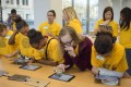 Members of the Kansas City Girls Who Code club complete a lesson on computer coding on iPads at the Apple store in the city. Photo: Kansas City Star/TNS