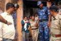 Indian police officials escort Juhi Choudhury. Photo: AFP