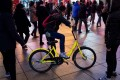 A girl rides an Ofo bicycle in Shanghai. Photo: AFP