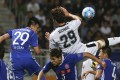 Eastern's Diego Eli Moreira (front) and Leung Chun-pong (left) fight for the ball with Kawasaki Frontale's Michael Fitzgerald during the AFC Champions League draw between the sides. Photos: Jonathan Wong