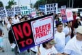 Participants join a protest against plans to reimpose the death penalty. Photo: Reuters