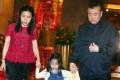 A 2013 photo of Chan Hoi-wan (left) and partner Joseph Lau Luen-hung leaving Fook Lam Moon restaurant in Wan Chai with their daughter. Photo: Sam Tsang