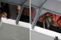 A monkey peering into a 12th floor HDB unit in Bukit Panjang. Photos: Raj Nadarajan