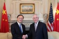 Visiting Chinese State Councillor Yang Jiechi shakes hands with US Secretary of State Rex Tillerson during their meeting in Washington D.C. Photo: Xinhua