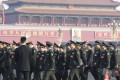 Senior officials of the People's Liberation Army walk to the Great Hall of the People in Tiananmen Square in Beijing on Saturday. Photo: Kyodo