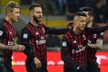 AC Milan's Gianluca Lapadula (right) celebrates with teammates after scoring a penalty against Chievo. Photo: AFP
