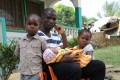 James Harris, the husband of Salome Karwah, sits with his children in his home in Monrovia. Photo: AFP