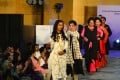 """Bangladeshi acid attack survivors walk the runway during the fashion show """"Beauty Redefined"""". Photo: AFP"""