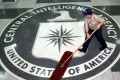 A worker at the CIA sweeping the foyer clean at the CIA headquarters in Langley, Virginia, as whistleblower website WikiLeaks released documents on the agency's cyber espionage toolkit. Photo: EPA
