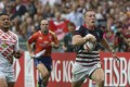 Alex McQueen streaks away from his Japan opponent in the final of the qualifying competition at last year's Hong Kong Sevens. Photo: KY Cheng