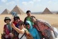Tourists pose for a selfie in front of the famed pyramids in Giza, Egypt, as tourism in the country has largely recovered from the unrest following the 2011 uprising. Photo: EPA