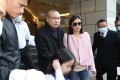 Former chairman of Chinese Estates Joseph Lau Luen-hung, accompanied by his wife Chan Hoi-wan and daughter, leave China Evergrande Centre in Wan Chai on March 2, 2017. Photo: Edward Wong