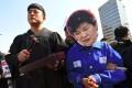 An anti-government activist wearing a mask depicting Park Geun-hye. Photo: AFP