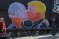 A mural on a restaurant wall in the Lithuanian capital, Vilnius, depicts US President Donald Trump and Russian President Vladimir Putin greeting each other with a kiss. Photo: AFP