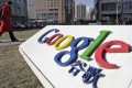 A woman walks past the logo of Google in front of its headquarters in Beijing in 2011. Google has been keen to return to China since it pulled out in 2010. Photo: Reuters