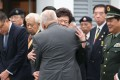 Former chief executive Tung Chee-hwa hugs Carrie Lam Cheng Yuet-ngor during the ceremony to commemorate Nanjing Massacre. Photo: K. Y. Cheng