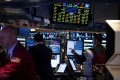 Traders work on the floor of the New York Stock Exchange. Since Donald Trump became US president, global stock markets have shot up 8.3 per cent. Photo: Bloomberg