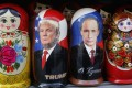 Traditional Russian Matryoshka dolls depict Russian President Vladimir Putin (right) and Donald Trump at a street souvenir shop in St Petersburg, Russia. Photo: AP