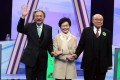 Chief executive candidates John Tsang, Carrie Lam and Woo Kwok-hing are all smiles at the start of the debate. Photo: K. Y. Cheng