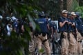 Police prepare to storm a hideout of suspected Islamist extremists at Chittagong. Photo: AFP
