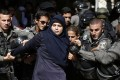 Israeli security forces arrest a Palestinian woman during clashes between Palestinian protesters and Israeli police at the al-Aqsa mosque compound in old city of Jerusalem in 2015. Photo: AFP