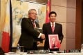 Philippine Trade Secretary Ramon Lopez shakes hands with China's Commerce Minister Zhong Shan in Manila last week. Photo: Reuters