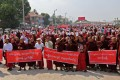 Monks and ethnic Mon shout slogans during a rally in Mawlamyine in Myanmar's Mon State. Photo: AFP