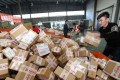 A worker processes packages for delivery at a sorting centre in Lianyungang during the Singles' Day online shopping festival on November 11, 2016. Last year, 31.3 billion parcels were sent in the country. Photo: AFP